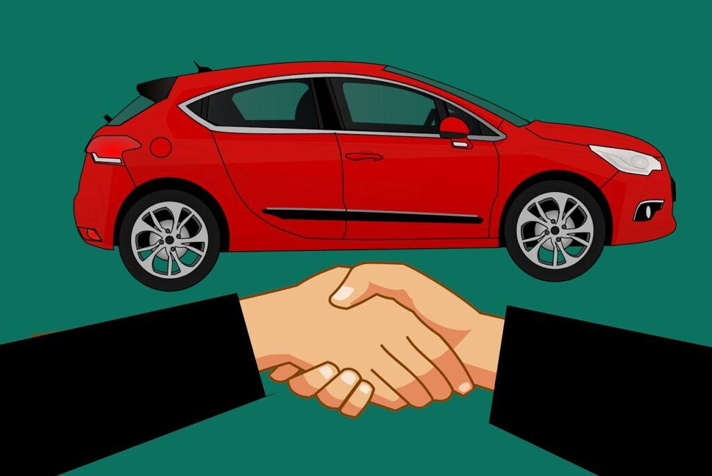 na zdjęciu czerwone auto oraz uścisk dłoni